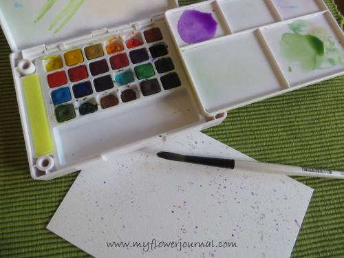 Splattered paint background for a simple Watercolor Flower Wreath painting-myflowerjournal.com