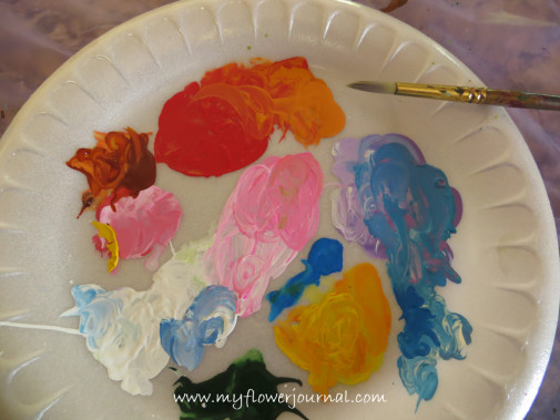 Use a paper plate to put your paints on for your splattered paint flower garden-myflowerjournal.com