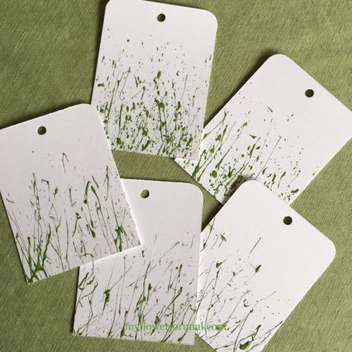 Gift tags with splatterd acrylic paint ready to add watercolor flowers from myflowerjournal.com